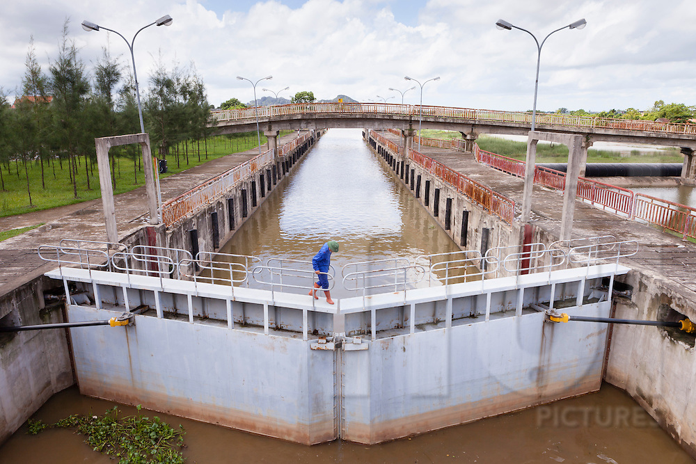 A canal lock beside Dong Thai Lake in Yen Mo District, Ninh Binh Province, Vietnam, Southeast Asia