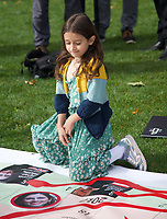 Gabriella Ratcliffe, Richard Ratcliffe. At the  photocall the  took place in Parliament Square to mark Nazanin Zaghari-Ratcliffe's 2000th day of being detained in Iran, A giant snakes and ladders board was used to show the ups and downs of Nazanin's case