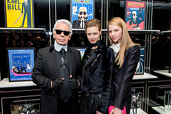 (L-R) Karl Lagerfeld, Lindsey Wixson and Sasha Luss during the opening of French illustrator Tiffany Cooper's exhibition of fake movie posters starring Karl Lagerfeld held at the Karl Lagerfeld boutique in St-Germain-des-Pres district in Paris, France on March 7, 2015. Photo by ABACAPRESS.COM