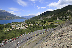 The peloton led by Team Sky start to climb Cote de Demoiselles Coiffees at Lac de Serre-Poncon during Stage 18 of the 104th edition of the Tour de France 2017, running 179.5km from Briancon to the summit of Col d'Izoard, France. 20th July 2017.<br /> Picture: Eoin Clarke | Cyclefile<br /> <br /> All photos usage must carry mandatory copyright credit (© Cyclefile | Eoin Clarke)