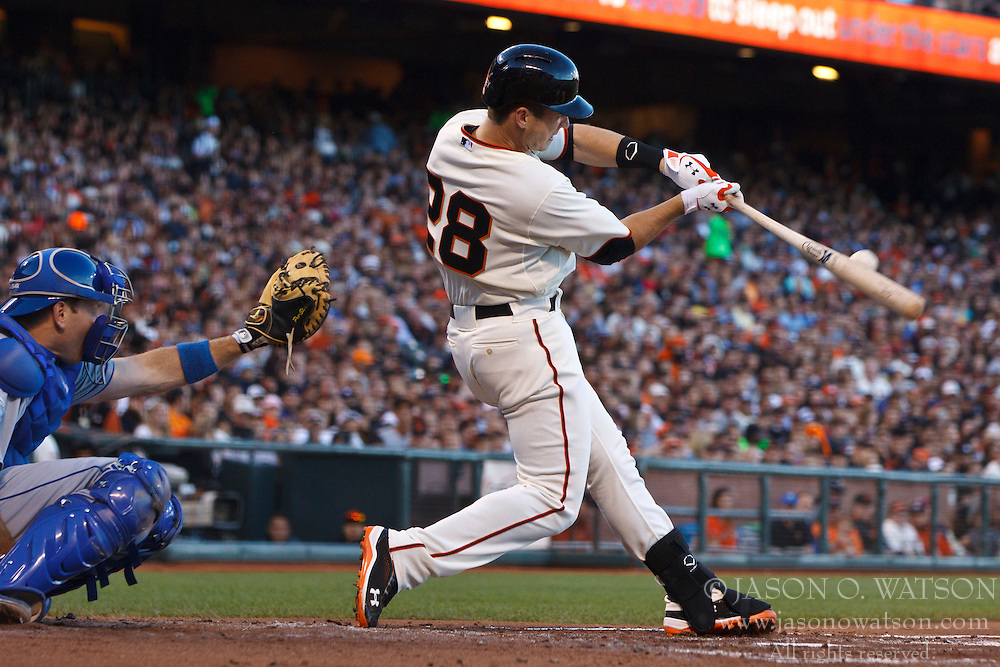 SAN FRANCISCO, CA - JUNE 26: Buster Posey #28 of the San Francisco Giants hits a double against the Los Angeles Dodgers during the second inning at AT&T Park on June 26, 2012 in San Francisco, California. The San Francisco Giants defeated the Los Angeles Dodgers 2-0. (Photo by Jason O. Watson/Getty Images) *** Local Caption *** Buster Posey