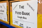 Trussell Trust Food Bank box for two adults (couple) waiting for distribution in the Wadebridge foodbank, North Cornwall, England, United Kingdom. The box has been prepared by volunteers and contains non-perishable food items.