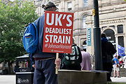 A sign at an anti-Brexit demonstration calls Boris Johnson, the British Prime Minister, the UKs deadliest strain of the countrys Covid-19 variants on 24th June, 2021 in Leeds, United Kingdom. The British government has been under mounting pressure and criticism for their response to the pandemic, with many saying the Prime Minister has repeatedly acted irresponsibly and endangered lives.