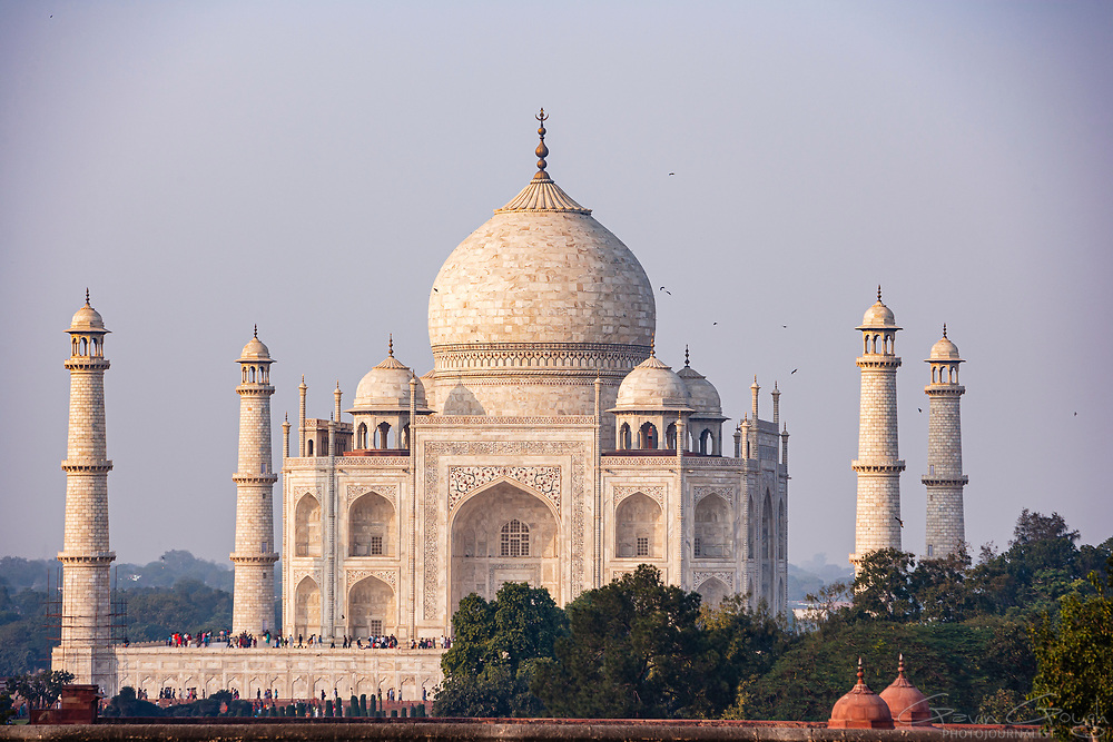 A view of the iconic ivory-white marble towers and dome, Taj Mahal, Agra, India