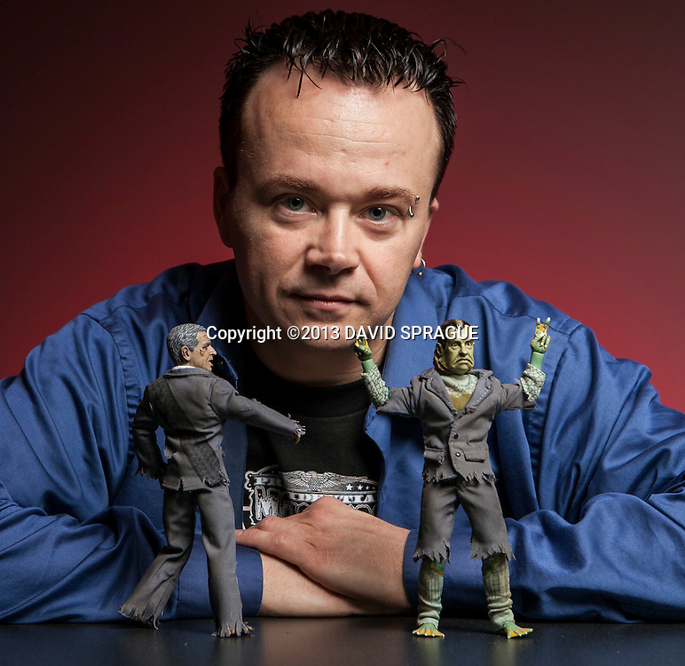 Mark Huckabone of Heroes in Action Toys shows off his latest line of presidential monster action figures. Shot Feb. 5th,  2013Photo by David Sprague ©2013