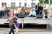 Couple age 60 dancing to the Scott Miller Band. Grand Old Day Street Fair St Paul Minnesota USA