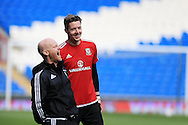 Wayne Hennessey, the Wales goalkeeper shares a joke with a coaching staff member during the Wales football team training at the Cardiff City Stadium in Cardiff, South Wales on Wed 23rd March 2016. The team are preparing for their forthcoming friendly against Northern Ireland.<br /> pic by  Andrew Orchard, Andrew Orchard sports photography.