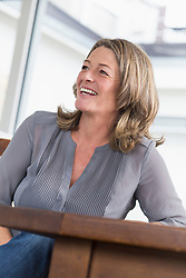 Smiling mature woman at table