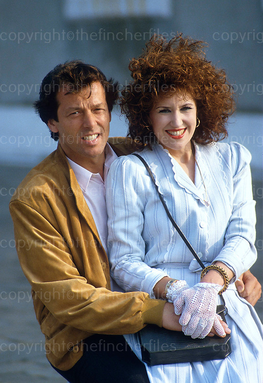 Leslie Grantham and Anita Dobson, stars of 'Eastenders' soap opera seen in Venice, Italy in 1986 during filming of an 'Eastenders' special. Photo by Terry Fincher.