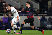 Midfielder Giovani Lo Celso of Tottenham and Defender Ethan Ampadu Of Leipzig compete for the ball during the UEFA Champions League match between Tottenham Hotspur and RB Leipzig, at The Tottenham Hotspur Stadium, Thursday, Feb. 20 2020,  in  London, United Kingdom. (Mitchell Gunn/Image of Sport)