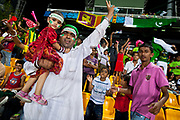 Jubilant fans celebrate the Pakistan national cricket team win over Australia at the 2011 ICC cricket world cup, Colombo, Sri Lanka.