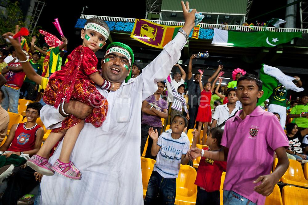 Jubilant fans celebrate the Pakistan national cricket team win over Australia at the 2011 ICC cricket world cup, Colombo, Sri Lanka.