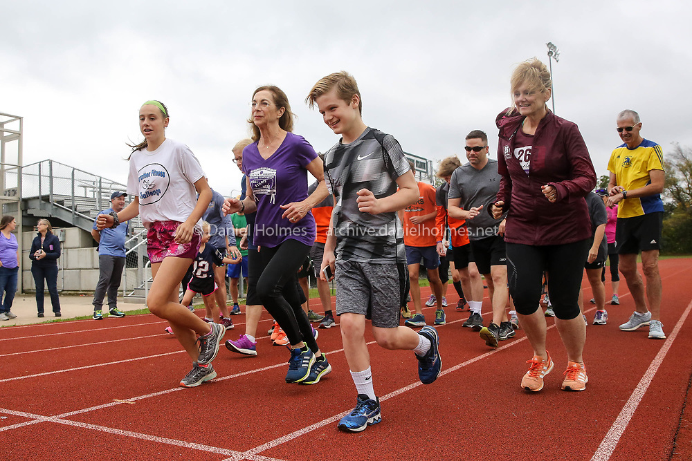 (10/15/17, HOPKINTON, MA) Marathon runner Kathrine Switzer, center, and runners take off for a run at Hopkinton Middle School on Sunday. [Daily News and Wicked Local Photo/Dan Holmes]