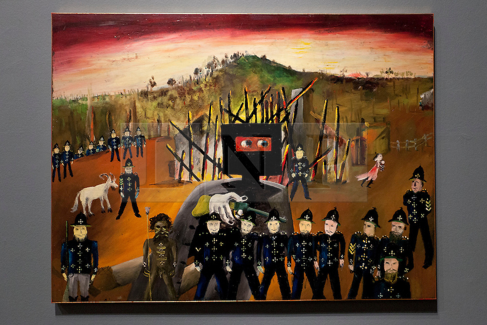 © Licensed to London News Pictures. 17/09/2013. London, UK. 'Glenrowan' (1970‑1), part of the iconic series of paintings by Australian artist Sidney Nolan portraying the Australian outlaw, is seen at the press view for the Royal Academy of Arts latest exhibition 'Australia' in London today (17/09/2013). The exhibition, said to be the most significant survey of Australian art ever mounted in the UK, spans more than 200 years, from 1800 to the present, and runs from the 21st of September to the 8th of December 2013. Photo credit: Matt Cetti-Roberts/LNP