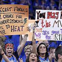 12 June 2012: Fans shows written cardboards during the Oklahoma City Thunder 105-94 victory over the Miami Heat, in Game 1 of the 2012 NBA Finals, at the Chesapeake Energy Arena, Oklahoma City, Oklahoma, USA.