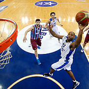 Anadolu Efes's Alfred Jamon Lucas (C) and Trabzonspor's Andrija Stipanovic (L) during their BEKO Basketball League match Anadolu Efes between Trabzonspor at Abdi Ipekci Arena in Istanbul Turkey on Sunday 23 February 2014. Photo by Aykut AKICI/TURKPIX