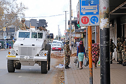 JOHANNESBURG, SOUTH AFRICA - APRIL 18: Army members during a South African Police Service (SAPS) Metro Police and Army supported patrol in Rockey Street, Yeoville. Random searchs and social distancing measures on April 18, 2020 in Johannesburg South Africa. Under pressure from a global pandemic. President Ramaphosa declared a 21 day national lockdown extended by another two weeks, mobilising goverment structures accross the nation to combat the rapidly spreading COVID-19 virus - the lockdown requires businesses to close and the public to stay at home during this period, unless part of approved essential services. (Photo by Dino Lloyd)