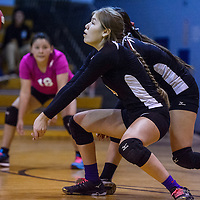 Saint Michael Jalynn SMith (4) bumps up a serve from the Red Mesa Redskins Thursday at the Fort Defiance Fieldhouse.