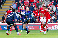 Luton Town midfielder Alan McCormack (4) and Barnsley forward Jacob Brown (33) battle in the middle of the park  during the EFL Sky Bet League 1 match between Barnsley and Luton Town at Oakwell, Barnsley, England on 13 October 2018.