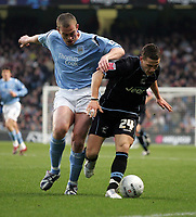 Photo: Paul Thomas.<br />Manchester City v Scunthorpe United. The FA Cup.<br />07/01/2006.<br />City's Richard Dunne (L) battles with Billy Sharp.