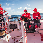 Leg 7 from Auckland to Itajai, day 15 on board MAPFRE, Blair Tuke steering with Antonio Cuervas-Mons and Tamara on deck, 01 April, 2018.