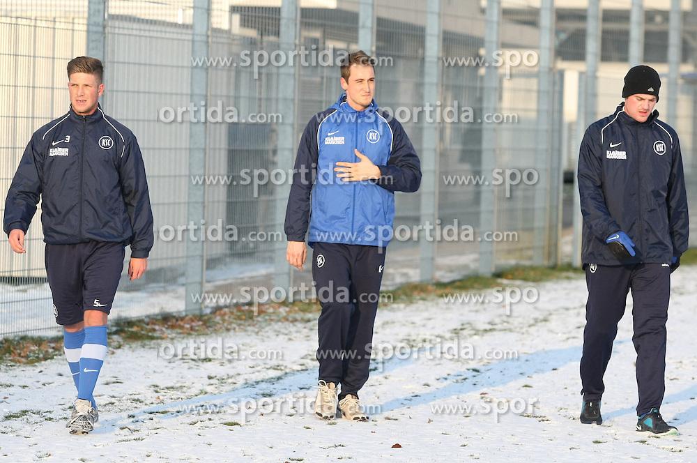 01.02.2012, Trainingsgelaende Wildparkstadion, Karlsruhe, GER, 2.FBL, Karlsruher SC, Training, im Bild Nach dem Laufen: v.l.n.r.: Dennis KEMPE (Karlsruher SC), Clemens VOGT (Karlsruher SC) und Klemen LAVRIC (Karlsruher SC). EXPA Pictures © 2012, PhotoCredit: EXPA/ Eibner/ Güngoer ATTENTION - OUT OF GER *****