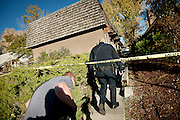 Salt Lake City Police Department officers cross into the secure area investigating an armed home invasion shooting at 2300 Green Street in Salt Lake City, Tuesday, Oct. 30, 2012.