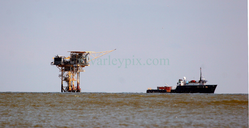 05 May 2010. Venice, Louisiana. Deepwater Horizon, British Petroleum environmental oil spill disaster.<br /> An oil rig sits close to the mouth of the Mississippi river just south of Venice. Rigs are dotted throughout the Gulf coast, many much closer to shore than the failed Deepwater Horizon platform.<br /> Photo credit;Charlie Varley/varleypix.com