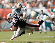 New England Patriots tight end Daniel Graham is hit by Miami Dolphins linebacker Zach Thomas during the Dolphins 21-0 victory over the New England Patriots on December 10, 2006 at Dolphin Stadium in Miami, Florida.