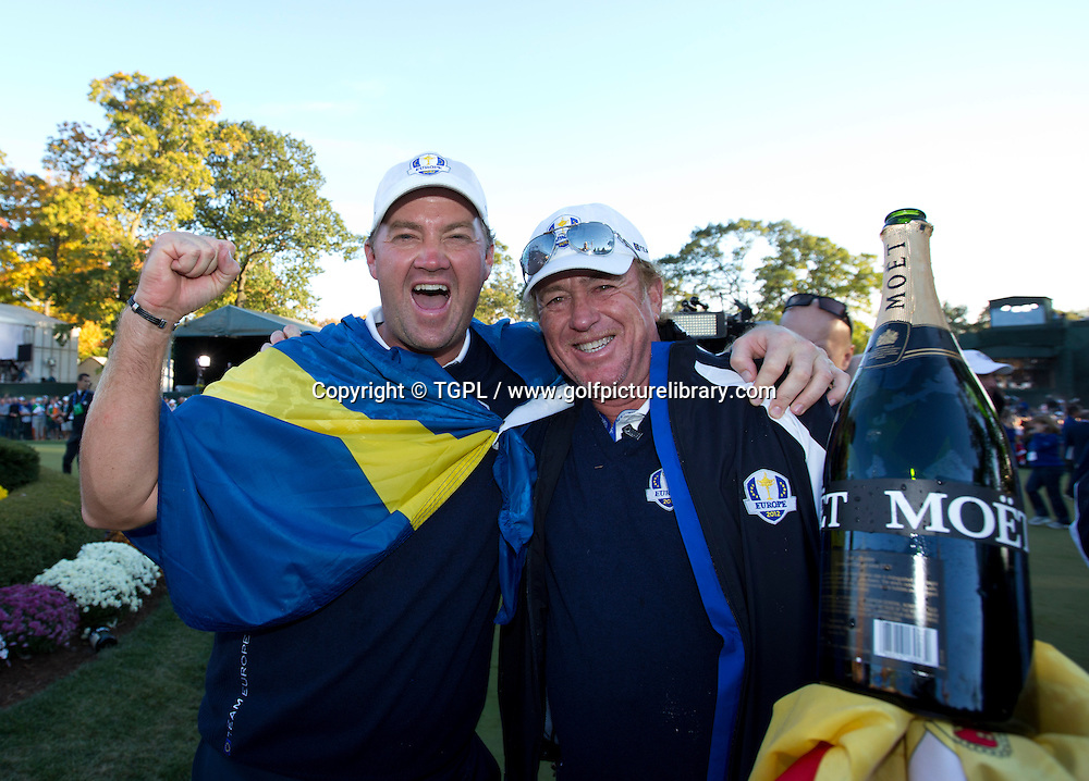 Peter HANSON (EUR) and Miguel Angel JIMENEZ (EUR)  celebrate victory during final day Singles,Ryder Cup Matches,Medinah CC,<br /> Medinah,Illinois,USA.