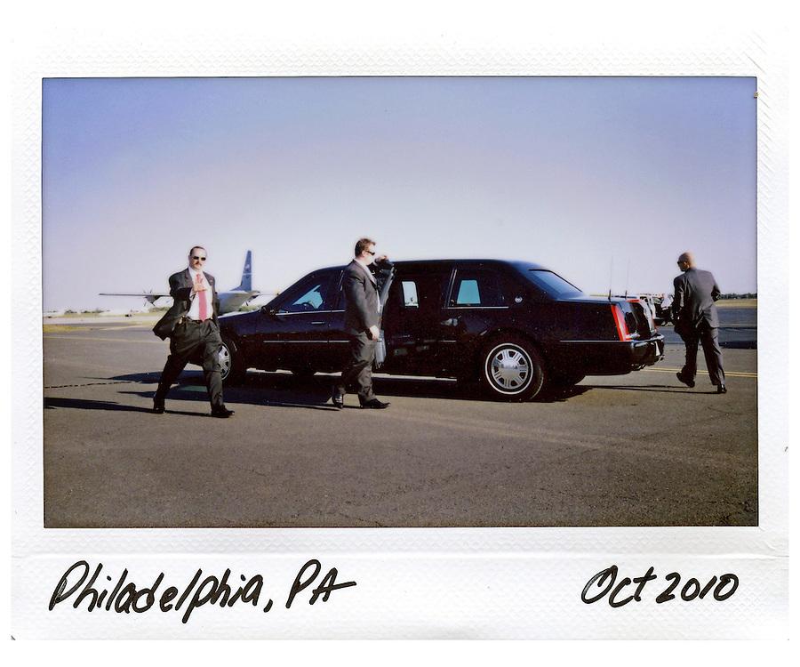U.S. Secret Service agent's provides security for U.S. President Barack Obama's limousine on the tarmac in Philadelphia, October 10, 2010.