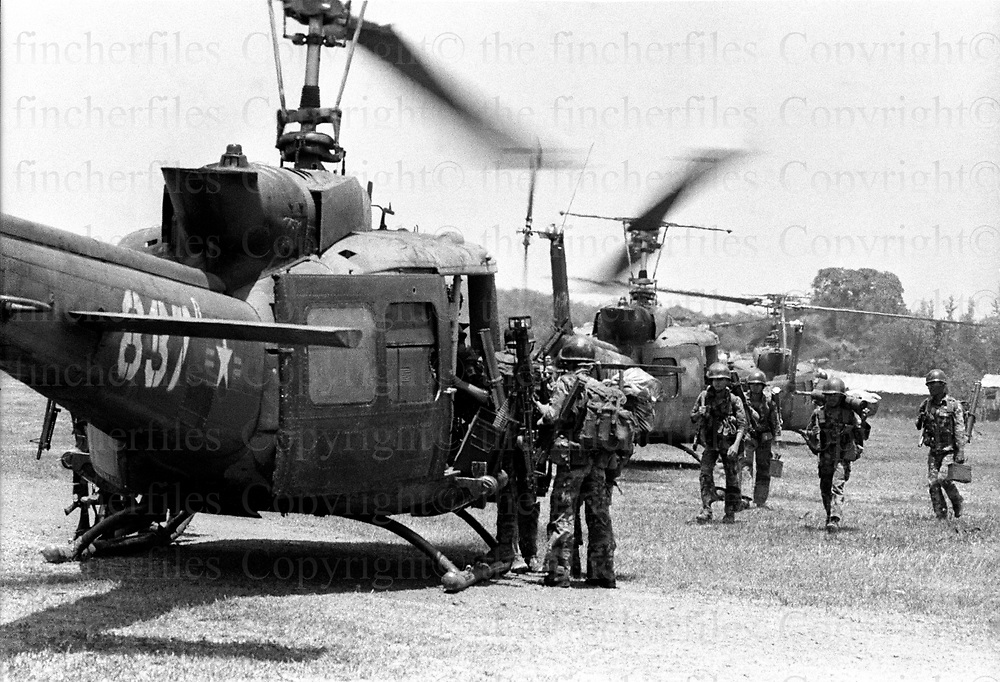 Evacuations of the wounded by South Vietnamese army soldiers on highway one, the battle scarred rhighway one oad from Xuan Loc to Saigon. South Vietnamese Boeing CH-47 Chinook, helicopters airlifts in supplies of ammunition's and troops. Xuan Loc was the last major battle of the Vietnam War fought between 9th and 21st April 1975. Photographed by  Terry Fincher.