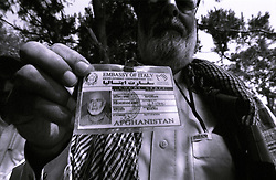 Khost, 20 August 2005..A local engineer, working for the Italian Embassy, shows is ID card