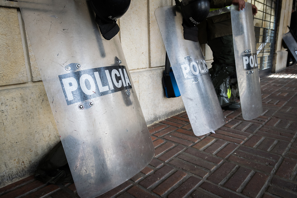 23 April 2018, Bogotá, Colombia. The Candelaria is the historic centre of Bogota, featuring old colonial architecture and narrow streets. Here, Police officers guard the Bolivar square.