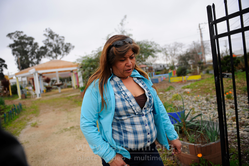 Rita Acosta, who has helped organize her fellow homeless into a coherent community with rules, walks through the Chinatown Community Gardens. Despite her own situation, she frequently helps others before herself, especially the seniors who are the most vulnerable.