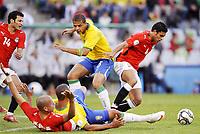 Fotball<br /> Brasil v Egypt<br /> Foto: DPPI/Digitalsport<br /> NORWAY ONLY<br /> <br /> FOOTBALL - CONFEDERATIONS NATIONS CUP 2009 - GROUP B - 1ST ROUND - BRAZIL v EGYPT - 15/06/2009 <br /> <br /> AHMED SAID (EGY) / FELIPE MELO (BRA)