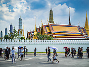 15 OCTOBER 2016 - BANGKOK, THAILAND: People mourning the death of Bhumibol Adulyadej, the King of Thailand, cross the street in front of the Grand Palace in Bangkok. King Bhumibol Adulyadej died Oct. 13, 2016. He was 88. His death comes after a period of failing health. With the king's death, the world's longest-reigning monarch is Queen Elizabeth II, who ascended to the British throne in 1952. Bhumibol Adulyadej, was born in Cambridge, MA, on 5 December 1927. He was the ninth monarch of Thailand from the Chakri Dynasty and is known as Rama IX. He became King on June 9, 1946 and served as King of Thailand for 70 years, 126 days. He was, at the time of his death, the world's longest-serving head of state and the longest-reigning monarch in Thai history.      PHOTO BY JACK KURTZ