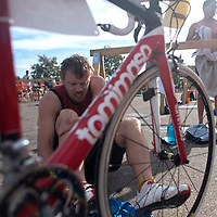 061415      Cayla Nimmo<br /> <br /> John Lomasney transitions from swimming to the bike ride of the Gallup Triathalon Saturday.