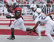 Lindenwood University - Belleville RB Kameron Harris (22), who played at Althoff High School, runs in a touchdown in the first half of their Homecoming Game against the Menlo College Oaks.  He raised his hand as he acknowledged the cheers and applause from the Lindenwood student seating section as he crossed into the end zone.