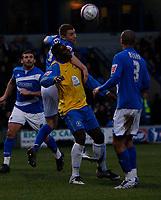 Photo: Steve Bond/Sportsbeat Images.<br />Macclesfield Town v Hereford United. Coca Cola League 2. 26/12/2007. Sean Hessey (CL) gets above Trevor Benjamin (C)