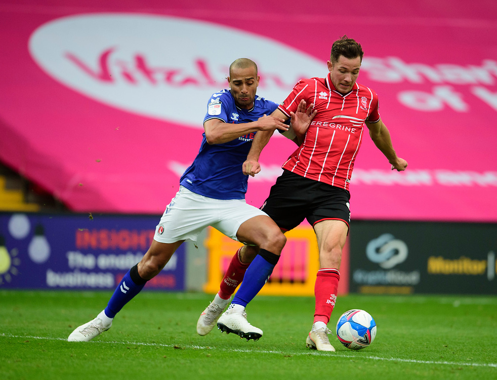 Lincoln City's Tom Hopper is fouled by Charlton Athletic's Darren Pratley<br /> <br /> Photographer Andrew Vaughan/CameraSport<br /> <br /> The EFL Sky Bet League One - Lincoln City v Charlton Athletic - Sunday 27th September, 2020 - LNER Stadium - Lincoln<br /> <br /> World Copyright © 2020 CameraSport. All rights reserved. 43 Linden Ave. Countesthorpe. Leicester. England. LE8 5PG - Tel: +44 (0) 116 277 4147 - admin@camerasport.com - www.camerasport.com