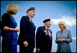 Image ©Licensed to i-Images Picture Agency. The Duchess of Cornwall talks to veterans l to r Laureen Harper the wife of the Canadian Prime Minister ,Lloyd Bentley 93, Stanley Clark Fields 95, on Juno Beach, Normandy, France, on the eve of the 70th anniversary of D-Day, Thursday, 5th June 2014 Picture by Andrew Parsons  / i-Images