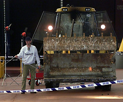 "An excavator at the scene after a raid on  350 million of diamonds on show at the Millennium Dome in SE London.  Six people were arrested, including four in the Money zone vault, and two by the River Thames, where the robbers had a powerboat.  *... waiting to speed them from the scene. In scenes reminiscent of the James Bond film The World is Not Enough, the raiders used a bulldozer to break into the Dome. Had it been successful, it would have been the world's largest ever robbery.    * 08/11/2001: Police foiled the ""robbery"" of the jewels when they caught raiders red handed as they smashed their way in using a mechanical digger, an Old Bailey court heard, at the opening of the trial of six men accused of plotting to rob the De Beers Millennium Diamond Exhibition with others unknown."