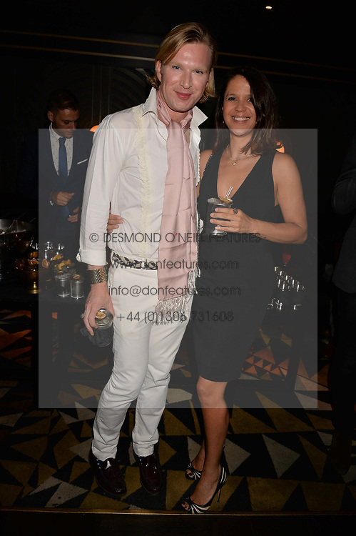 Lisa Moorish and Henry Conway at the Quaglino's Q Legends Summer Launch Party hosted by Henry Conway at Quaglino's, 16 Bury Street, London England. 18 July 2017.<br /> Photo by Dominic O'Neill/SilverHub 0203 174 1069 sales@silverhubmedia.com