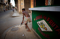 Cuban boy plays with toy guns