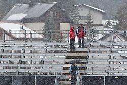 17.03.2011, Pista Silvano Beltrametti, Lenzerheide, SUI, FIS Ski Worldcup, Finale, Lenzerheide, Absage Feature Super-G, im Bild die beiden Super G-Rennen beim Finale in Lenzerheide wurden aufgrund schlechter Wetterbedigungen abgesagt. Drei Zuschauer verlassen das Stadiongelände  //  the two Super G Races in Lenzerheide are cancelled. pictured Fans are leaving the Finish Area during Men´s Downhill, at Pista Silvano Beltrametti, in Lenzerheide, Switzerland, 17/03/2011, EXPA Pictures © 2011, PhotoCredit: EXPA/ J. Feichter