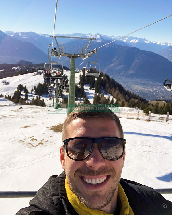 """Lukas Podolski releases a photo on Twitter with the following caption: """"""""Enjoying the last moments of a fun 2018. Never forget to smile! 😁💪🏻 #thankyou #LP10"""""""". Photo Credit: Twitter *** No USA Distribution *** For Editorial Use Only *** Not to be Published in Books or Photo Books ***  Please note: Fees charged by the agency are for the agency's services only, and do not, nor are they intended to, convey to the user any ownership of Copyright or License in the material. The agency does not claim any ownership including but not limited to Copyright or License in the attached material. By publishing this material you expressly agree to indemnify and to hold the agency and its directors, shareholders and employees harmless from any loss, claims, damages, demands, expenses (including legal fees), or any causes of action or allegation against the agency arising out of or connected in any way with publication of the material."""