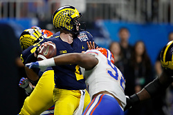 Michigan Wolverines quarterback Shea Patterson #2 throws a pass during the Chick-fil-A Peach Bowl, Saturday, December 29, 2018, in Atlanta. ( Paul Abell via Abell Images for Chick-fil-A Peach Bowl)