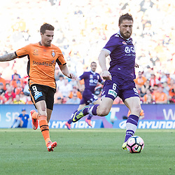 BRISBANE, AUSTRALIA - OCTOBER 30: Jamie MacLaren of the roar and Dino Djulbic of the Glory compete for the ball during the round 4 Hyundai A-League match between the Brisbane Roar and Perth Glory at Suncorp Stadium on October 30, 2016 in Brisbane, Australia. (Photo by Patrick Kearney/Brisbane Roar)