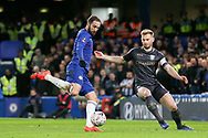 Chelsea Forward Gonzalo Higuain on loan from Juventus shoots at goal with Sheffield Wednesday defender Tom Lees (15) defending during the The FA Cup fourth round match between Chelsea and Sheffield Wednesday at Stamford Bridge, London, England on 27 January 2019.